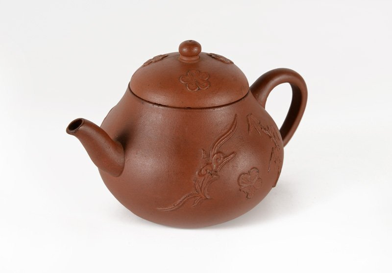 A yixing teapot decorated with the chilong dragon,