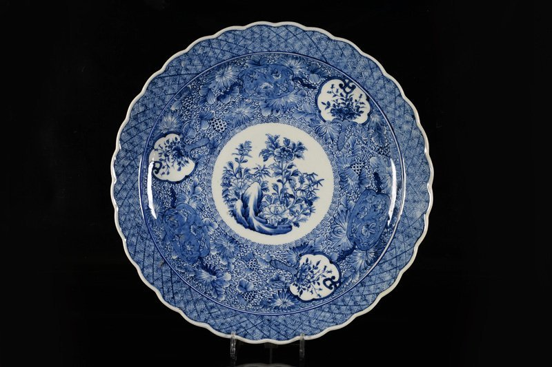 A porcelain plate, decorated with the three