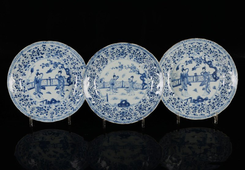 A set of three blue and white porcelain plates