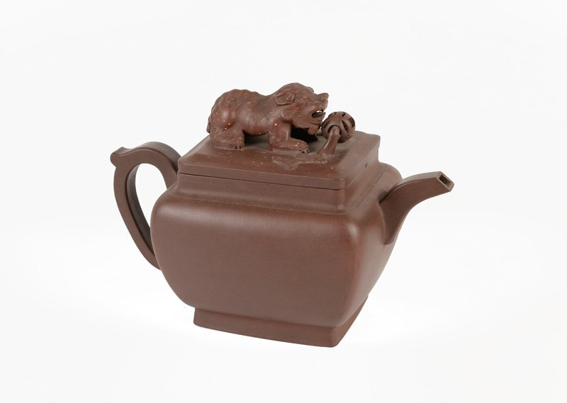 A red earthenware teapot, knob in the shape of a