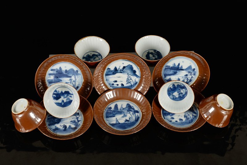 A set of six blue and white porcelain cups and saucers,