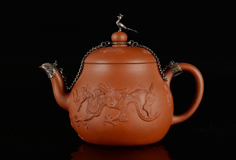 A Yixing teapot, decorated with two dragons and a
