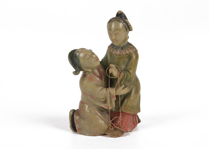 A soapstone sculpture of two court ladies. China, ca.