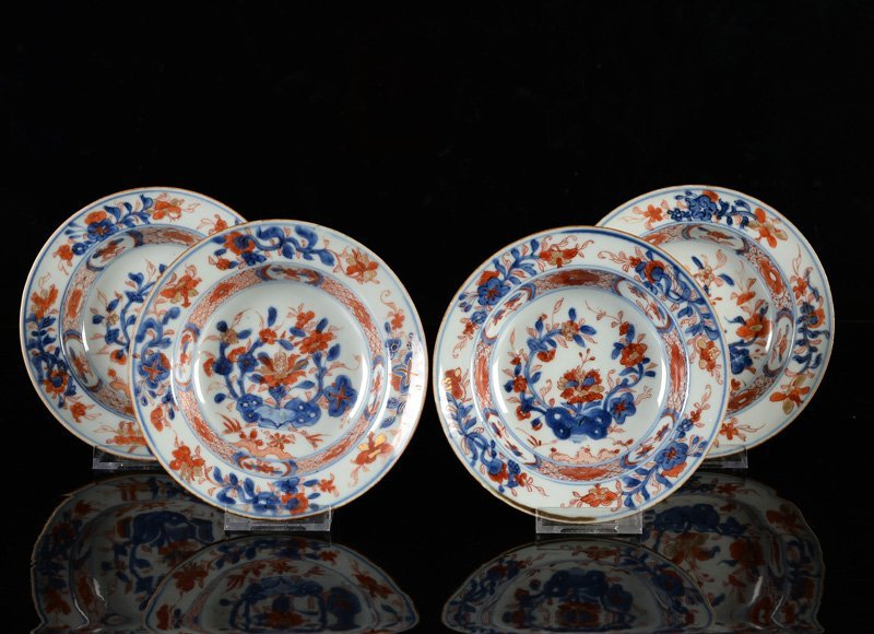 A lot of four Imari porcelain plates. China, Qianlong.