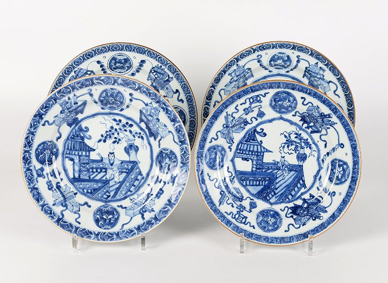 Four blue white porcelain plates with a decor of a boy