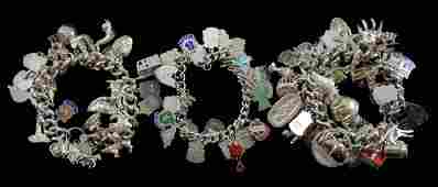 Three silver charm bracelets various charms including