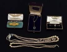 An opal bar brooch in Boodle  Dunthorne box mark