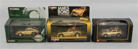 Three Corgi James Bond Aston Martin DB5 cars inclu