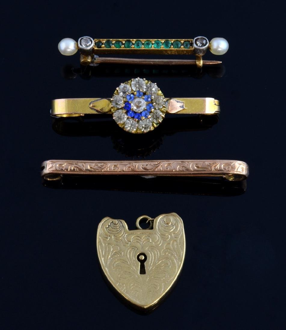 Group of small antique brooches, one with emerald