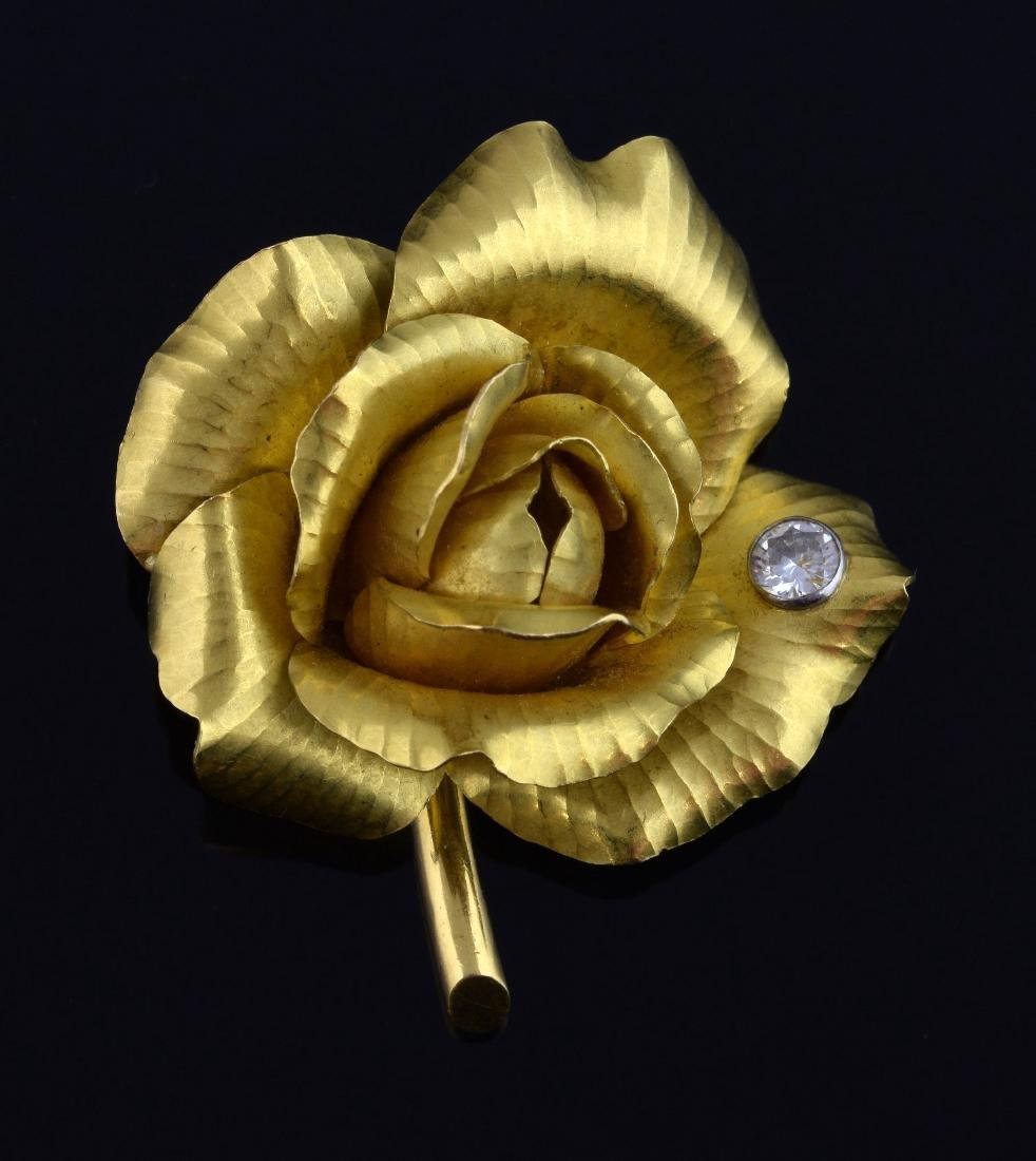 Cartier gold diamond set brooch in the form of a r