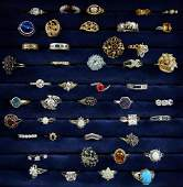 A collection of silver and costume jewellery rings