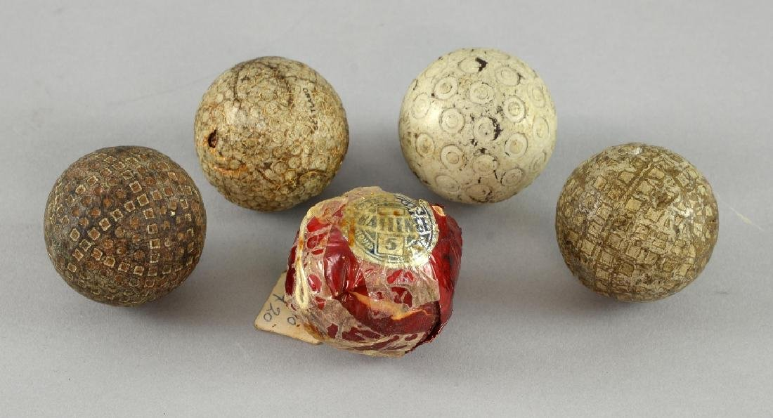 Five early 20th century golf balls including Zodia