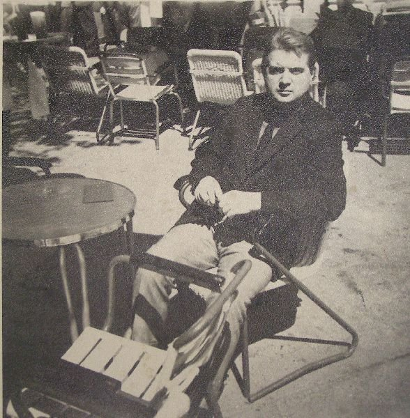 2015: Francis Bacon seated at a pavement cafe table. Bl