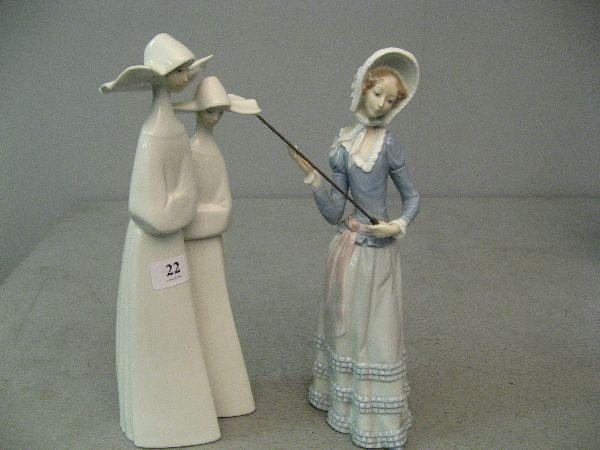 22: Lladro figure nuns and a girl in bonnet