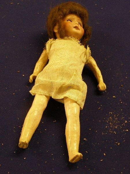 886: German bisque headed  doll, brown wig,