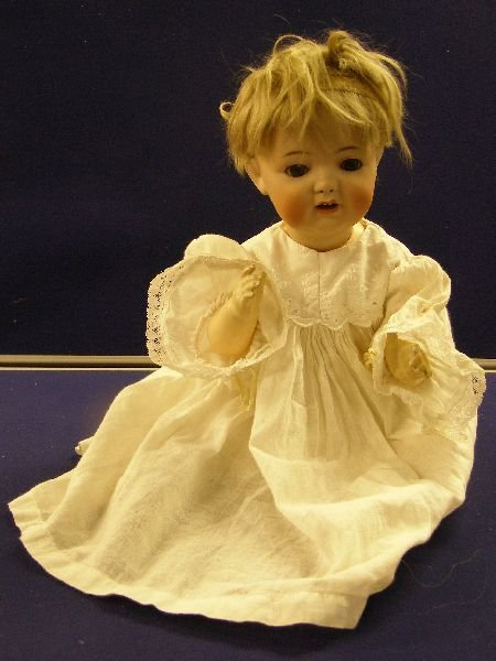 889: Early 20th century German bisque headed doll