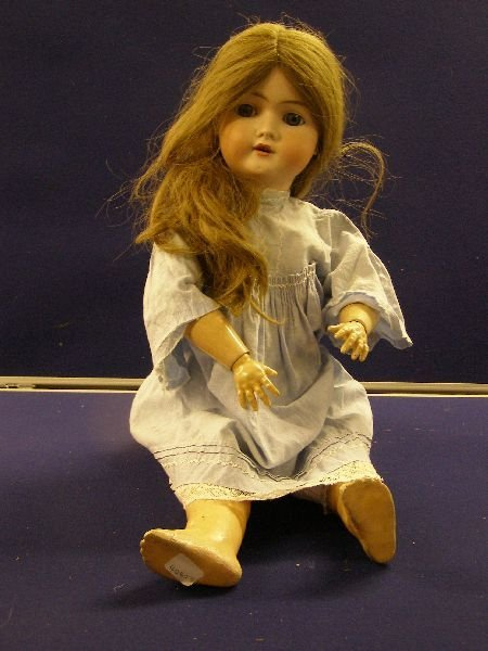 890: Early 20th century French bisque headed doll