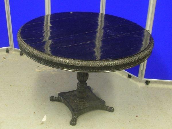 10: Mid-19th century black solid ebony circular