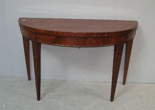 19: Mahogany oval card table,