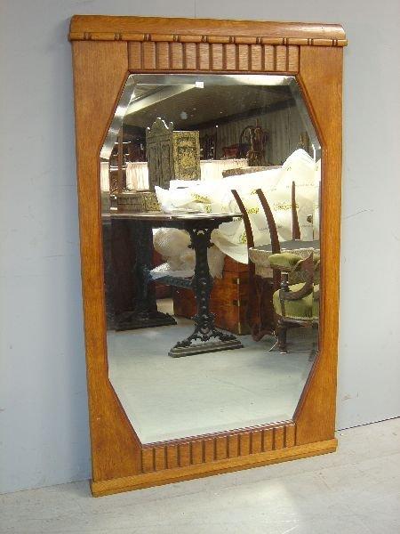 21: Oak-framed wall mirror with octagonal