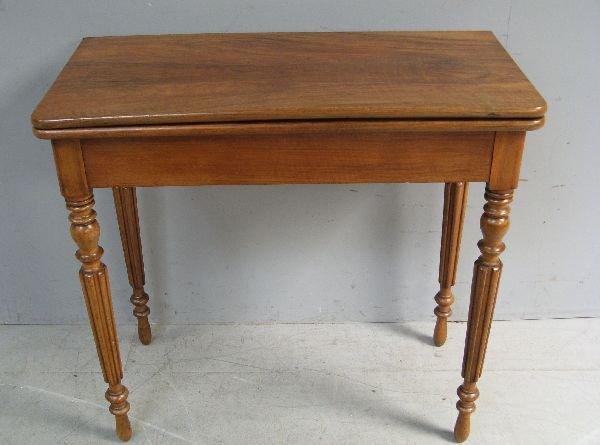 22: 19th century walnut folding card table