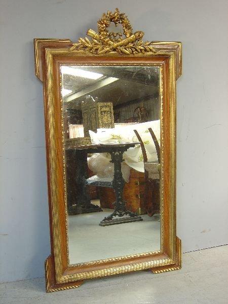24: Walnut and gilt-framed mirror,