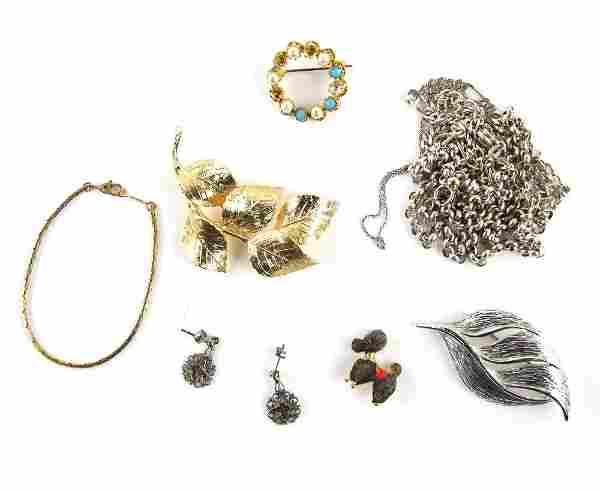 A group of costume jewellery, including silver bel