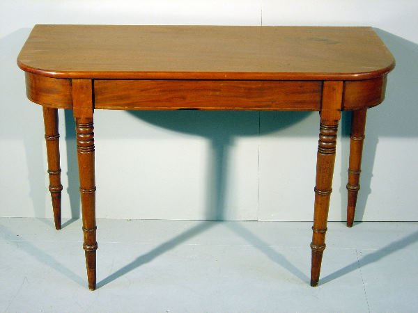 2: The end of a late George III mahogany dining table o