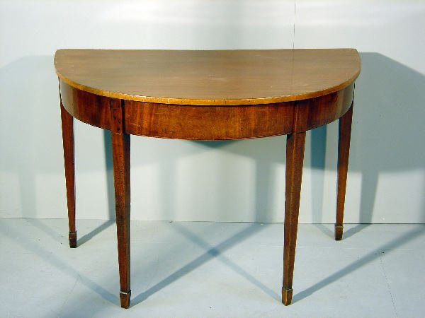 8: The D-end of a George III mahogany dining table, on