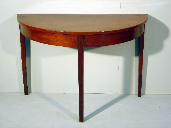 9: The D-end of a George III mahogany dining table on s