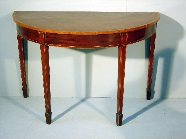 10: The end of a George III mahogany and crossbanded D-