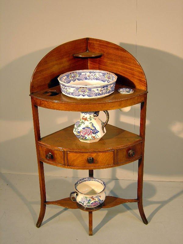14: George III mahogany corner washstand, the top with