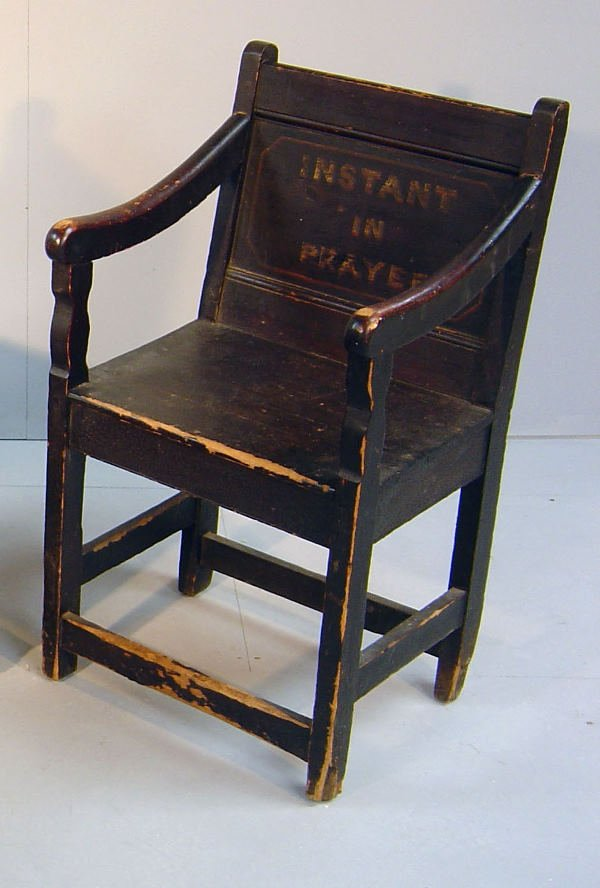 23: 18th century stained pine chair, the panelled back