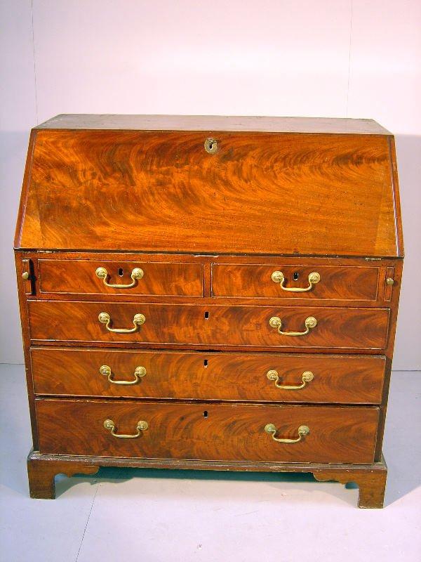 24: George III mahogany bureau, the fall flap revealing