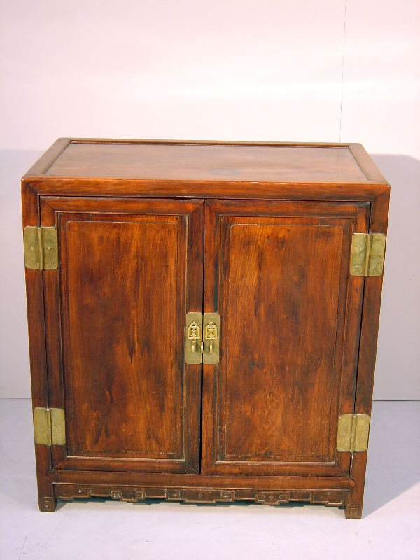 25: Chinese mahogany dwarf cupboard of panelled constru