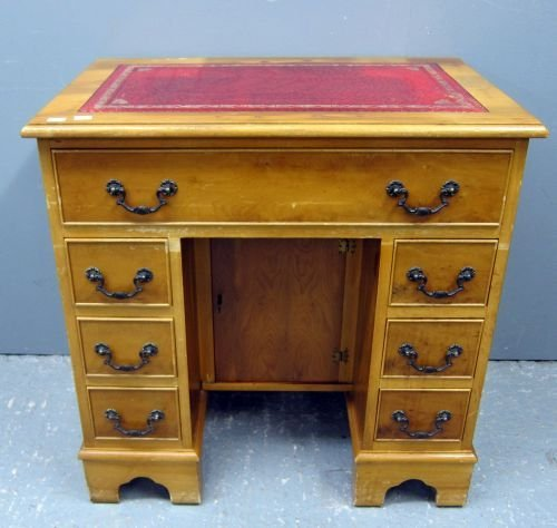 Yewwood kneehole desk with red leather inset top