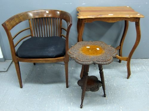 A walnut occasional table with undertier, tub chair and
