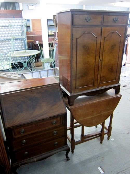Early 20th century mahogany bureau, cabinet and a table