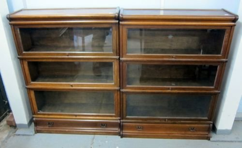 A pair of oak three section bookcases