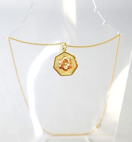 Gold floral pendant