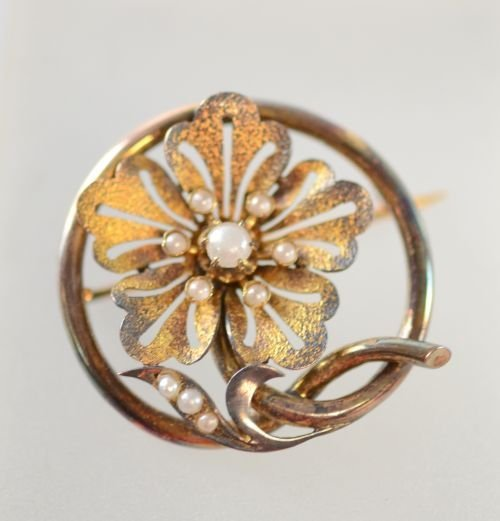 Floral brooch circular unhallmarked in naturalistic sty