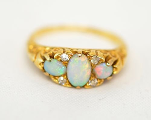 Late Victorian three stone opal and rose cut diamond ri