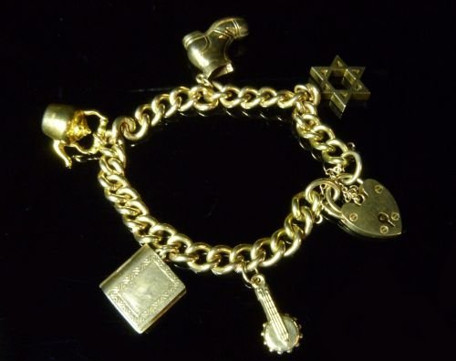 9ct gold bracelet with heart locket clasp and five asso