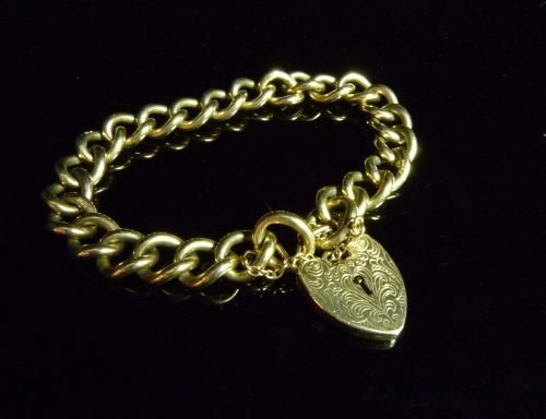9ct gold curb link chain with heart clasp 35 grams