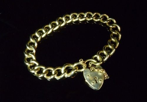 9ct gold bracelet with heart shaped padlock, 50 grams