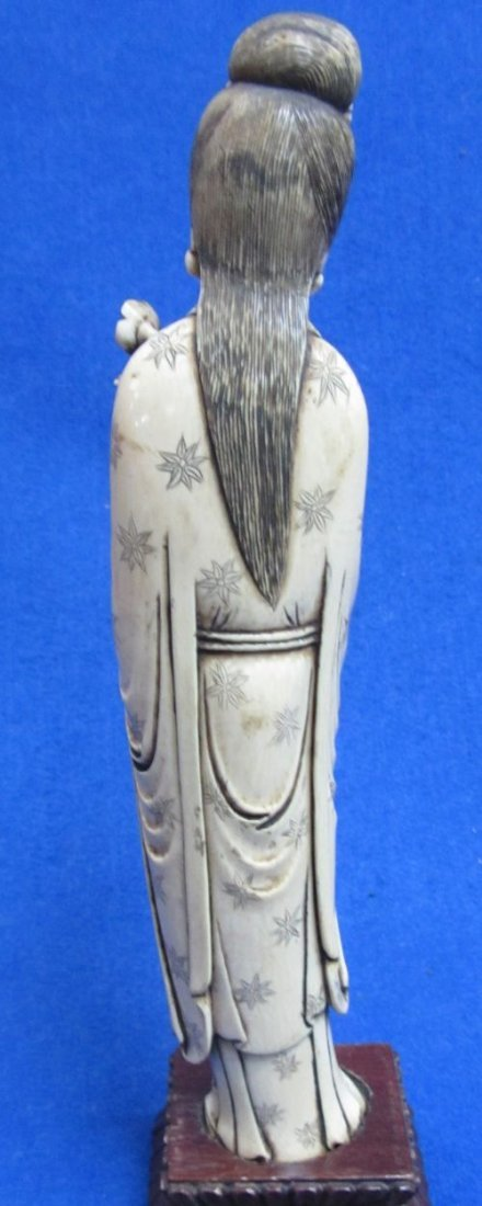 Chinese ivory carving of Ho Hsein Ku holding a peach bl