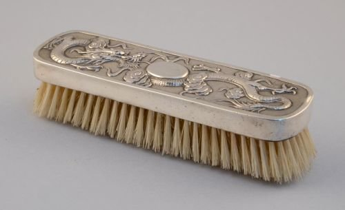 Chinese silver backed brush decorated with a writhing d