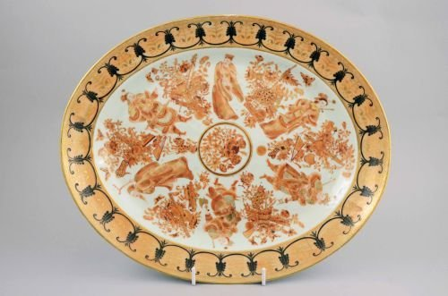 Chinese iron red, gilt and black dish decorated with Im