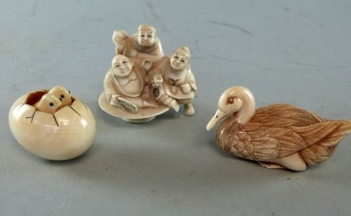 Three Japanese Ivory netsukes, one of a duck, one of a