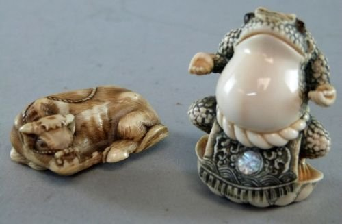 Two Japanese ivory netsukes, one of a toad, signed to b